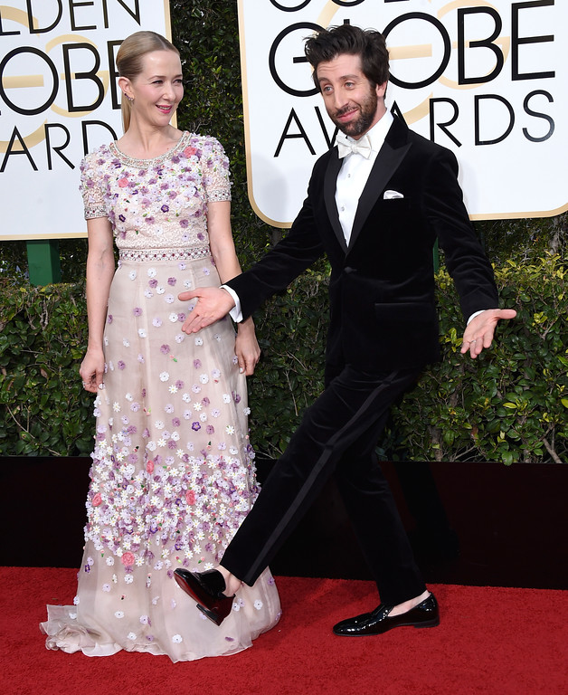 . Jocelyn Towne, left, and Simon Helberg arrive at the 74th annual Golden Globe Awards at the Beverly Hilton Hotel on Sunday, Jan. 8, 2017, in Beverly Hills, Calif. (Photo by Jordan Strauss/Invision/AP)