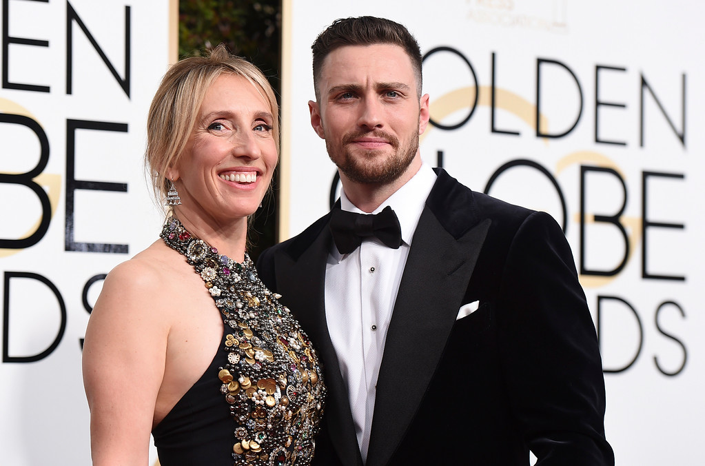 . Sam Taylor-Johnson, left, and Aaron Taylor-Johnson arrive at the 74th annual Golden Globe Awards at the Beverly Hilton Hotel on Sunday, Jan. 8, 2017, in Beverly Hills, Calif. (Photo by Jordan Strauss/Invision/AP)