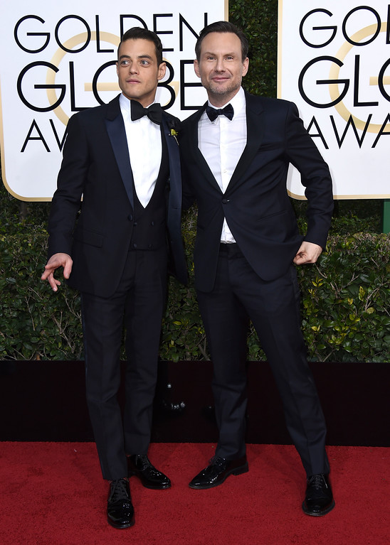. Rami Malek , left, and Christian Slater arrive at the 74th annual Golden Globe Awards at the Beverly Hilton Hotel on Sunday, Jan. 8, 2017, in Beverly Hills, Calif. (Photo by Jordan Strauss/Invision/AP)