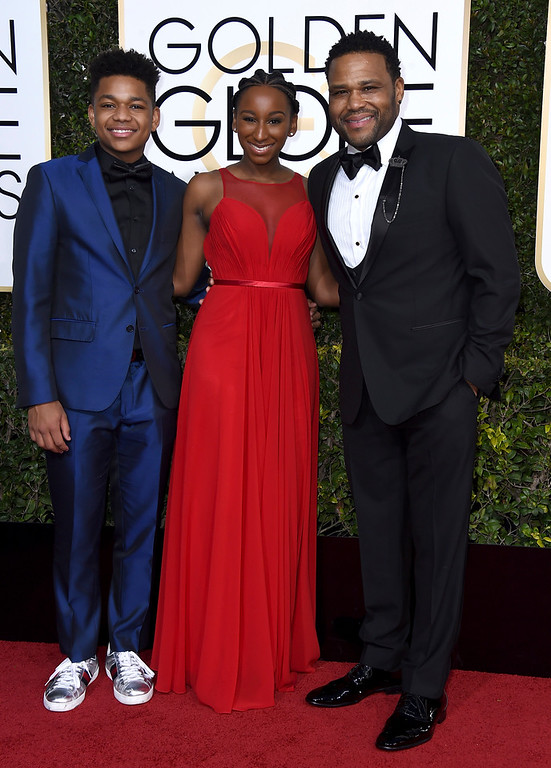 . Anthony Anderson, right, Kyra Anderson, center, and Nathan Anderson arrive at the 74th annual Golden Globe Awards at the Beverly Hilton Hotel on Sunday, Jan. 8, 2017, in Beverly Hills, Calif. (Photo by Jordan Strauss/Invision/AP)