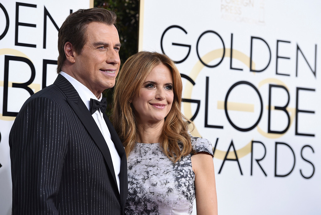 . John Travolta, left, and Kelly Preston arrive at the 74th annual Golden Globe Awards at the Beverly Hilton Hotel on Sunday, Jan. 8, 2017, in Beverly Hills, Calif. (Photo by Jordan Strauss/Invision/AP)