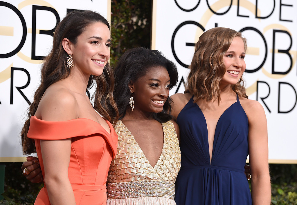 . Aly Raisman, from left, Simone Biles and Madison Kocian arrive at the 74th annual Golden Globe Awards at the Beverly Hilton Hotel on Sunday, Jan. 8, 2017, in Beverly Hills, Calif. (Photo by Jordan Strauss/Invision/AP)