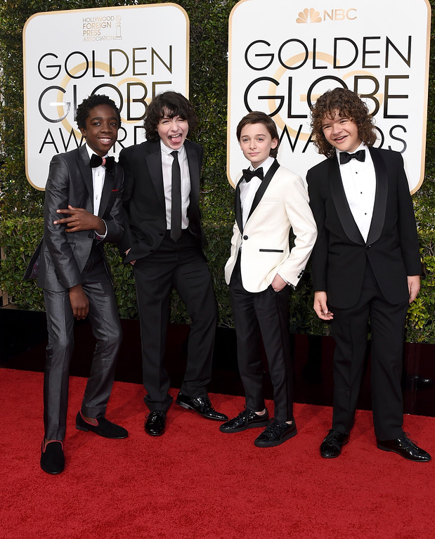 ". Caleb McLaughlin, from left, Finn Wolfhard, Noah Schnapp, and Gaten Matarazzo, from ""Stranger Things,\"" arrive at the 74th annual Golden Globe Awards at the Beverly Hilton Hotel on Sunday, Jan. 8, 2017, in Beverly Hills, Calif. (Photo by Jordan Strauss/Invision/AP)"