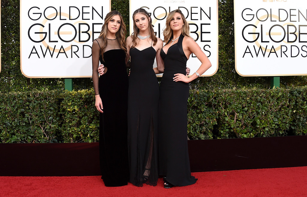 . Miss Golden Globes, Sistine Stallone, from left, Scarlet Stallone and Sophia Stallone arrive at the 74th annual Golden Globe Awards at the Beverly Hilton Hotel on Sunday, Jan. 8, 2017, in Beverly Hills, Calif. (Photo by Jordan Strauss/Invision/AP)