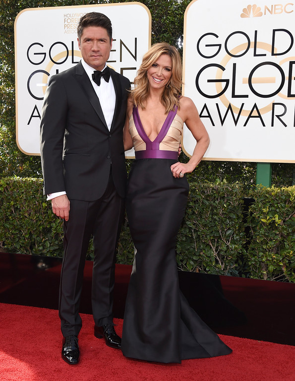 . Louis Aguirre, left, and Debbie Matenopoulos arrive at the 74th annual Golden Globe Awards at the Beverly Hilton Hotel on Sunday, Jan. 8, 2017, in Beverly Hills, Calif. (Photo by Jordan Strauss/Invision/AP)