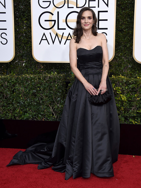 . Winona Ryder arrives at the 74th annual Golden Globe Awards at the Beverly Hilton Hotel on Sunday, Jan. 8, 2017, in Beverly Hills, Calif. (Photo by Jordan Strauss/Invision/AP)