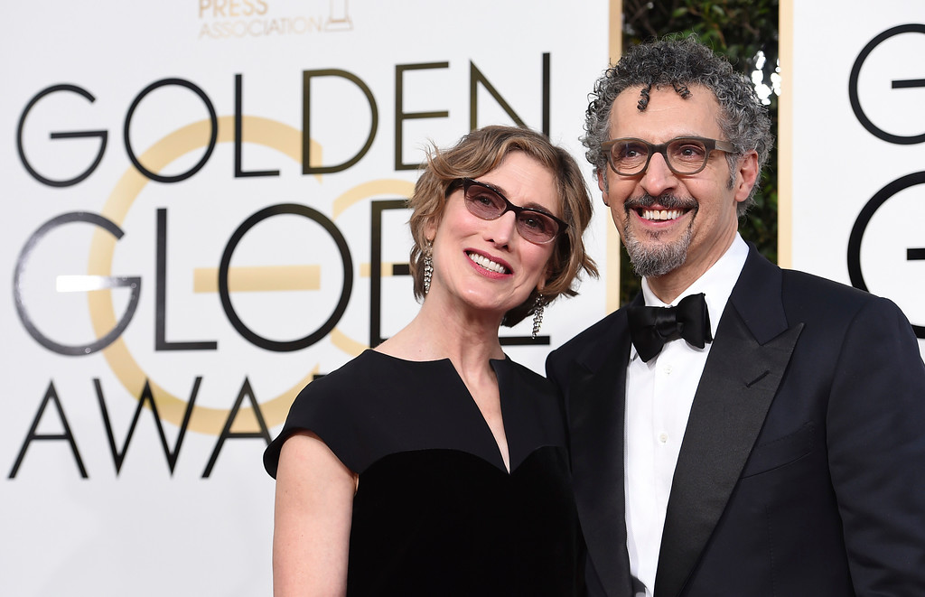 . Katherine Borowitz, left, and John Turturro arrive at the 74th annual Golden Globe Awards at the Beverly Hilton Hotel on Sunday, Jan. 8, 2017, in Beverly Hills, Calif. (Photo by Jordan Strauss/Invision/AP)
