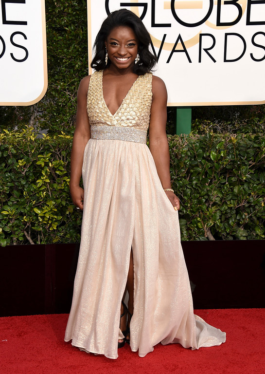 . Simone Biles arrives at the 74th annual Golden Globe Awards at the Beverly Hilton Hotel on Sunday, Jan. 8, 2017, in Beverly Hills, Calif. (Photo by Jordan Strauss/Invision/AP)