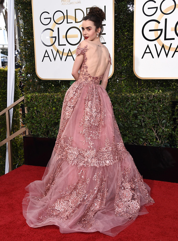. Lily Collins arrives at the 74th annual Golden Globe Awards at the Beverly Hilton Hotel on Sunday, Jan. 8, 2017, in Beverly Hills, Calif. (Photo by Jordan Strauss/Invision/AP)