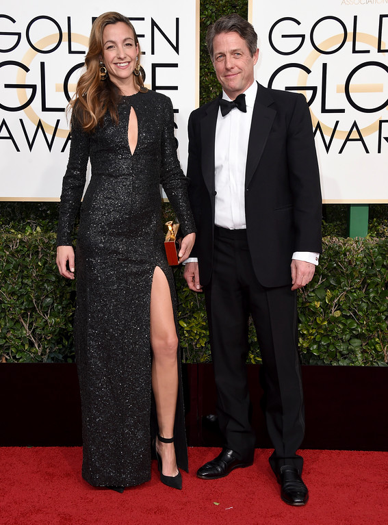 . Anna Elisabet Eberstein, left, and Hugh Grant arrive at the 74th annual Golden Globe Awards at the Beverly Hilton Hotel on Sunday, Jan. 8, 2017, in Beverly Hills, Calif. (Photo by Jordan Strauss/Invision/AP)