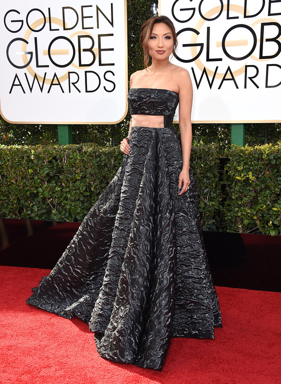 . Jeannie Mai arrives at the 74th annual Golden Globe Awards at the Beverly Hilton Hotel on Sunday, Jan. 8, 2017, in Beverly Hills, Calif. (Photo by Jordan Strauss/Invision/AP)