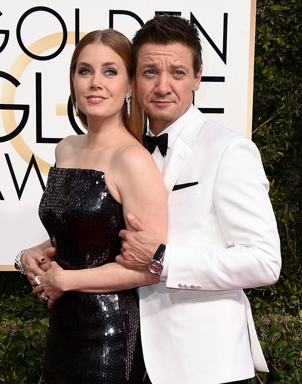 . Amy Adams, left, and Jeremy Renner arrive at the 74th annual Golden Globe Awards at the Beverly Hilton Hotel on Sunday, Jan. 8, 2017, in Beverly Hills, Calif. (Photo by Jordan Strauss/Invision/AP)