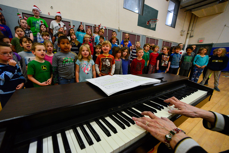"Rita Corey, musical director for the Dummerston Elementary School, plays the piano while students rehearse on Tuesday, Dec. 6, 2016, for their concert ""Holiday Windows - A Musical Play About the Holiday Season,"" on Wednesday. The show will start around 6:30 p.m. in the school's gymnasium. KRISTOPHER RADDER - BRATTLEBORO REFORMER"