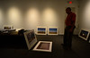 "John Willis, a professor of photography at Marlboro College, arranges his show ""House/Home, a work in progress,"" at the Brattleboro Museum and Arts Center on Tuesday, Aug. 30, 2016. Kristopher Radder / Reformer Staff"