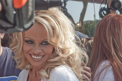 PamAnderson_MOM_lp_040910_1006 Pam Anderson, animal rights activist, pin-up girl, actress, model, celebrity and Dancing With The Stars contestant, introduces a new vegan milkshake at Millions of Milkshakes in West Hollywood, CA 04/09/2010. Pamela Anderson smiles as she is surrounded by cameras while being interviewed and photographed at her arrival at Millions of Milkshakes, West Hollywood CA.