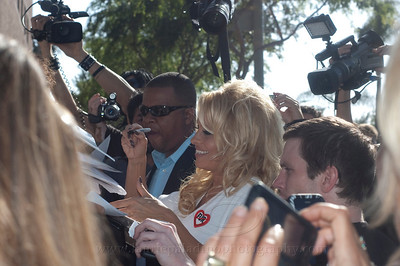 PamAnderson_MOM_lp_040910_1057  Pam Anderson, animal rights activist, pin-up girl, actress, model, celebrity and Dancing With The Stars contestant, introduces a new vegan milkshake at Millions of Milkshakes in West Hollywood, CA 04/09/2010 and afterwards signs autographs for waiting fans. Pam is wearing a 'no fur' button on her white dress.