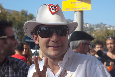 Animal-friendly actor Corey Feldman shows up at the launch of Millions Of Milkshakes Vegan Milkshake introduced by Pamela Anderson and PETA. Corey Feldman flashes the peace sign at fans and photographers.