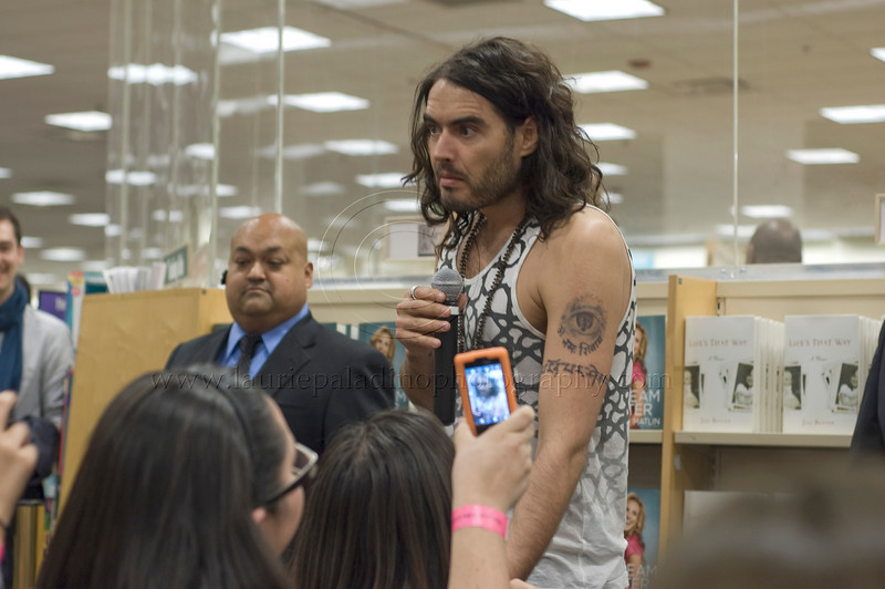 """RB_lp_050120009_1004<br /> A fan takes a camera phone photo of British comic, actor and author Russell Brand at his Barnes and Noble Los Angeles CA book signing appearance to promote his UK best-selling memoir, """"My Booky Wook"""" which was recently released in the United States."""