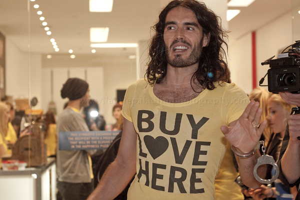 Russell Brand_BuyLoveHere__052710_1062 w.jpg<br /> <br /> British Comic, Actor, Author and subject of an upcoming documentary on consumerism and happiness, Russell Brand, hosts a pop-up store filmed as part of his documetary. Brand acted as a vendor and interviewed people who came to the pop-up store to swap their unwanted goods for donated stock. Russell Brand greets participants as they enter the pop-up store and wears a pair of handcuffs donated by a participant.