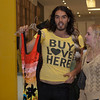RB_BuyLoveHere__052710_1040w.jpg<br /> <br /> British Comic, Actor, Author and subject of an upcoming documentary on consumerism and happiness, Russell Brand, hosts a pop-up store filmed as part of his documetary. Brand acted as a vendor and interviewed people who came to the pop-up store to swap their unwanted goods for donated stock. Russell Brand holds up a dress donated by his fiancee Katy Perry to the event for which a fan traded a pair of diamond earrings.