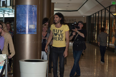 Russell Brand_BuyLoveHere__052710_1028w  .jpg  British Comic, Actor, Author and subject of an upcoming documentary on consumerism and happiness, Russell Brand, hosts a pop-up store filmed as part of his documetary. Brand acted as a vendor and interviewed people who came to the pop-up store to swap their unwanted goods for donated stock. Russell Brand talks to the people in line at the event at the Beverly Center Mall while being filmed for his upcoming documentary.
