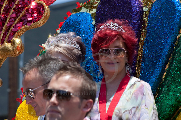 Sharon (foreground) and her daughter Kelly Osbourne smile at the cheering crowd as they serve as Grand Marshalls at The Los Angeles Pride Parade which takes place on Santa Monica Boulevard in West Hollywood, CA June 13, 2010. Sharon and Kelly Osbourne wave at the cheering fans lining Santa Monica Boulevard.