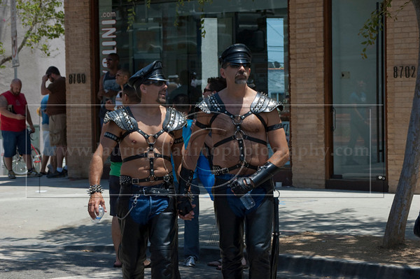 Two men dressed in leather bondage gear and leather caps attend The 40th Annual Los Angeles Pride Parade takes place on Santa Monica Boulevard in West Hollywood, CA June 13, 2010