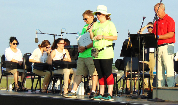 Diane Raver | The Herald-Tribune<br /> Tory Flynn, Hillenbrand director of communications and public affairs, thanks all the volunteers who helped in any way with this concert.
