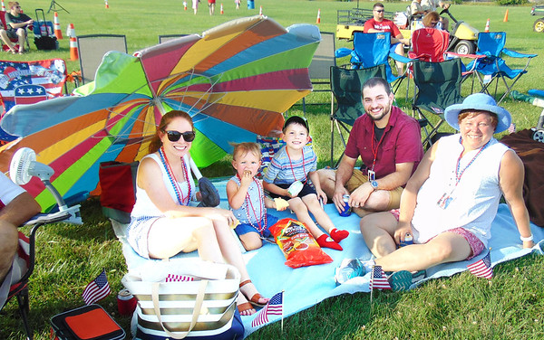 Diane Raver | The Herald-Tribune<br /> Mayor Mike Bettice's family members, including daughter Holly Enneking; grandkids Ellie Enneking, 2, and James Enneking, 5; son-in-law Scott Enneking; and wife Lorie Bettice, were all smiles as they found the perfect spot to view the concert.