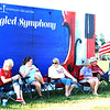 "Diane Raver | The Herald-Tribune<br /> Attendees could take pictures in front of the ""Star-Spangled Symphony"" sign."