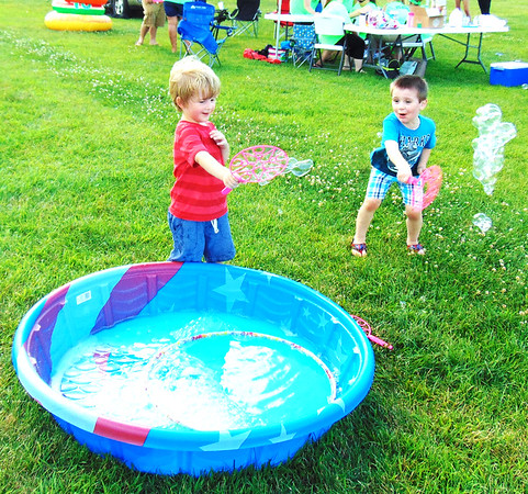 Diane Raver | The Herald-Tribune<br /> Payton Smith (left), 3, Batesville, and Jaxson Nohl, 4, Greensburg, were very excited to play with bubbles prior to the evening's entertainment.