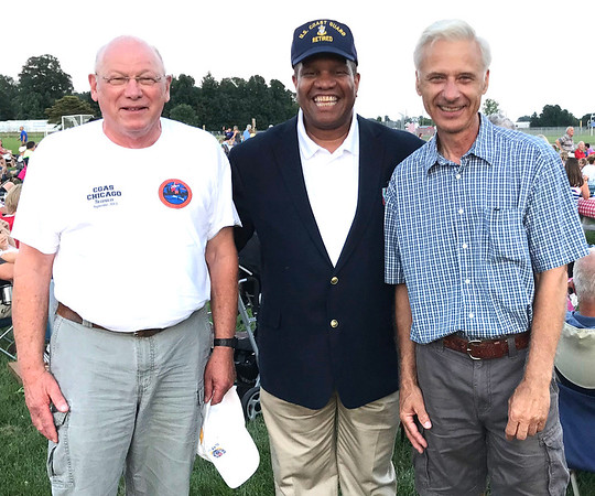 """Photo courtesy of Bill Blank<br /> Dr. Vince Patton (center) served as the Coast Guard master chief petty officer for four years until his 2002 retirement. He narrated """"Gardens of Stone"""" with Dean Dorrell, who portrayed Abraham Lincoln, as the orchestra played, then met the two Coast Guard veterans who stood during the """"Armed Forces Tribute,"""" Greg Westrup (left), Greensburg, and Ron Johnson, Batesville."""