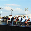 "Diane Raver | The Herald-Tribune<br /> The 75-member orchestra tunes up before starting about 15 minutes late to allow for the sun to set a bit more and avoid being in musicians' eyes. Pieces ranged from an Aaron Copland ""Fanfare for the Common Man"" and ""Glenn Miller Medley"" to the crowd-pleasing ""1812 Overture Solennelle, Opus 49"" by Piotr Tchaikovsky."