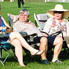 Diane Raver | The Herald-Tribune<br /> Spectators tried to stay cool out in the sun.