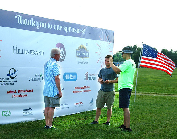 Diane Raver | The Herald-Tribune<br /> Committee members Michael Xenophontos (from right) and  Steven Harmeyer talk to Mayor Mike Bettice in front of the sponsor sign.