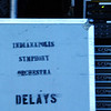 Debbie Blank | The Herald-Tribune<br /> A sign at the side of the stage shows the orchestra is used to delaying concerts.