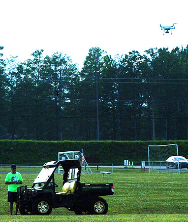 Debbie Blank | The Herald-Tribune<br /> A drone keeps an eye on the growing crowd early in the evening.