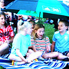Debbie Blank | The Herald-Tribune<br /> Batesville friends (from left) Rachel Suttmann, 11; Karsyn Watson, 12; Meg Ritter, 11 (partially obscured); Bella Watson, 9; and Bridget Lohmueller, 11, have fun while they wait for the music to begin.