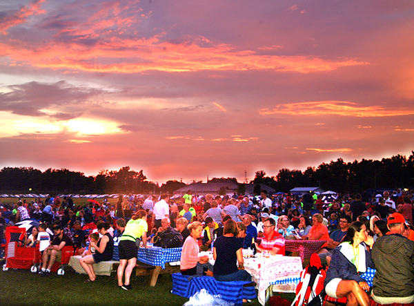 Debbie Blank | The Herald-Tribune<br /> After the rain, concert-goers were treated to a spectacular sunset and even a rainbow.