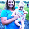 Debbie Blank | The Herald-Tribune<br /> Who's more excited about listening to the Indianapolis Symphony Orchestra outside? Nine-month-old Caden or his mom, Kari Bartal, Batesville?