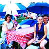 Debbie Blank | The Herald-Tribune<br /> After the all-clear announcement, Batesville Tool & Die friends (from left) Wende Lambert and Sabrina Andonegui Meneses and her husband Jorge Lopez returned to their table with handy umbrellas.
