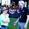 "Debbie Blank | The Herald-Tribune<br /> Tory Fynn (left), one of four ""Star-Spangled Symphony"" audience experience co-leads, chats with Indianapolis Symphony Orchestra CEO James Johnson after the storm, but before the music began."