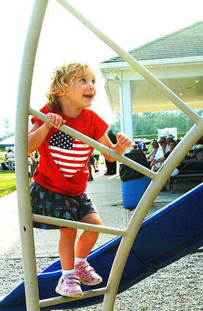 Debbie Blank | The Herald-Tribune<br /> Alyssa Marcy, 3, Batesville, frolics at the playground before the performance.