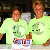 Debbie Blank | The Herald-Tribune<br /> Guest services volunteers Susan Dreyer (left) and Martha Harrington answered questions at the soccer concessions stand. They had plenty of company when the field was evacuated due to storms a half hour before the concert's 8 p.m. scheduled start.