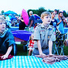 Debbie Blank | The Herald-Tribune<br /> Troop 634 Boy Scouts (from left) Matthew Skinner, 12, and Thomas Lohmueller and Cole Rudolf, both 13, made themselves useful by wiping rain off of sponsors' tables.