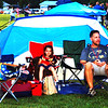 Debbie Blank | The Herald-Tribune<br /> As they await the rest of their family, Kyle Flynn, Batesville, and daughter Sophia, 7, were glad they had a tent. Originally they wanted it to block the sun's rays, but in the end it kept rain drops away.