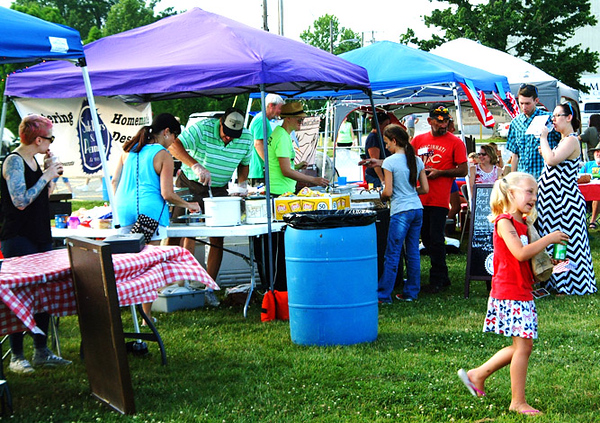 Debbie Blank | The Herald-Tribune<br /> Food booths served a variety of treats: sandwiches, Big Four Cafe; pulled pork, metts and brats, Snikkers & Peanuts; 2018 award-winning Walsman Woods Peach Salsa and popcorn grown by Langeland Farms, Greensburg, Food and Growers Association; and iced coffee, Amack's Well.