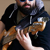 Holly Pelczynski - Bennington Banner Grady King, picks the strings of his bass on Thursday afternoon while playing at the South St. Cafe.