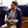 Holly Pelczynski - Bennington Banner Sam Clemet, guitarist for the band That Strange plays guitar for patrons at the South Street cafe on Thursday afternoon in Bennington.