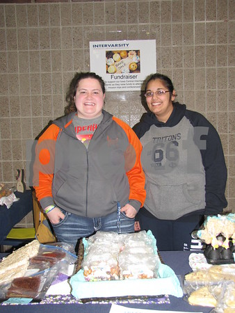 "Sam Streeter and Shanti Persaud sell baked goods for Intervarsity Christian Fellowship during the production of ""All Shook Up""."